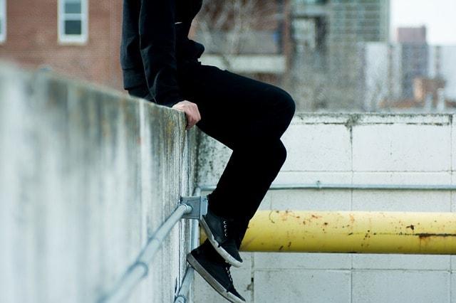 man sitting wearing casual shoes