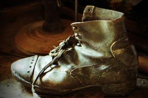old torn and worn leather boots